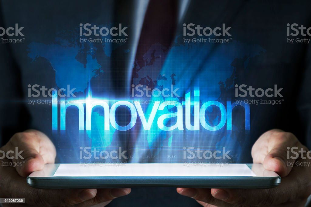 Innovation concept on tablet with hologram stock photo