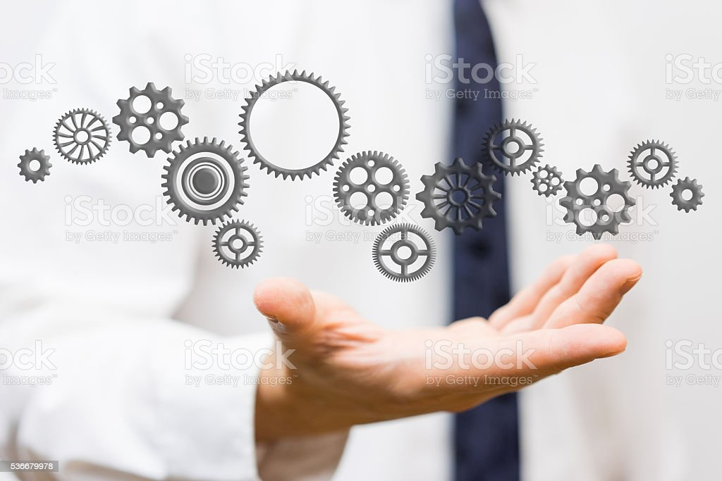 innovator showing connected sprockets,  ideas and changing technologies stock photo