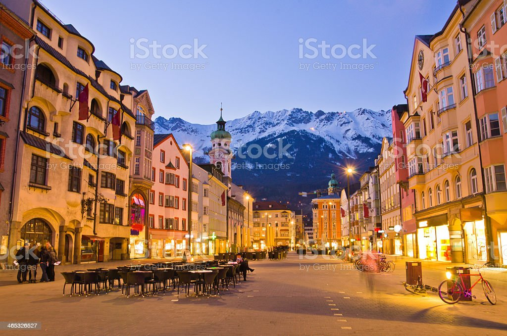 Innsbruck city center with snowy mountains on the background stock photo