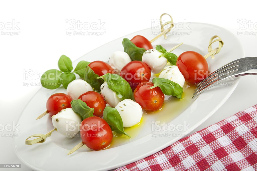 insalata caprese sticks on plate, tilted view royalty-free stock photo