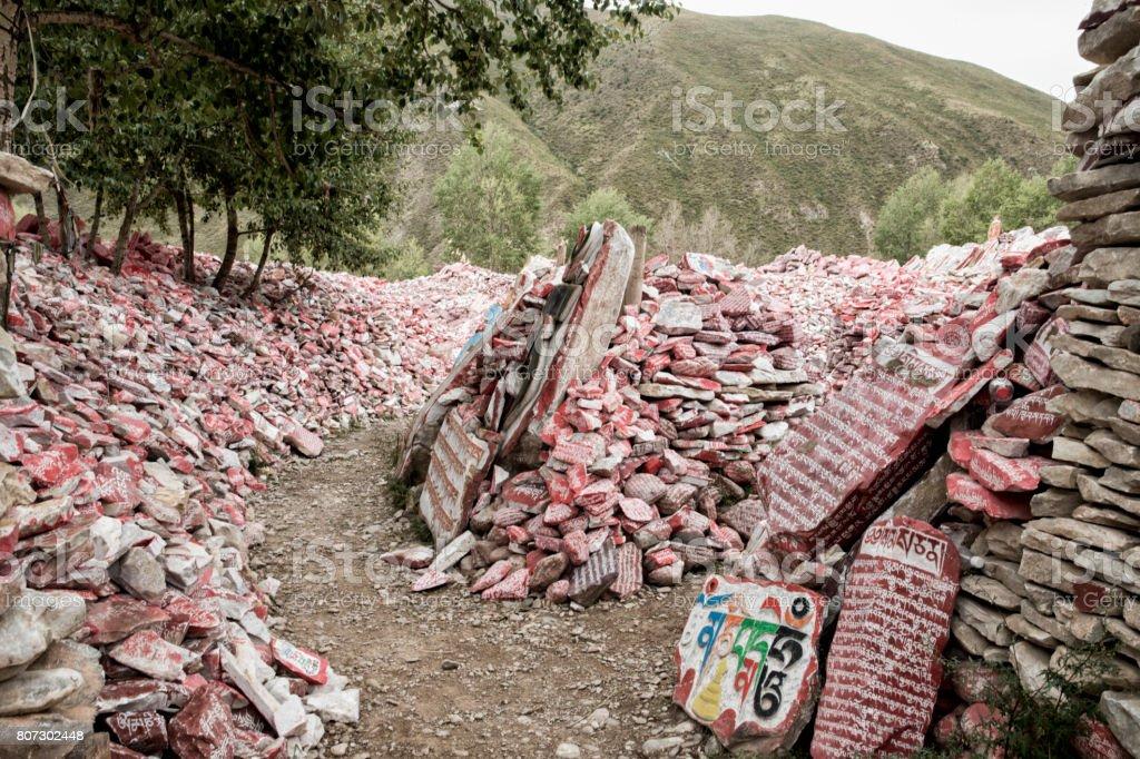Inscribed mani stones stock photo