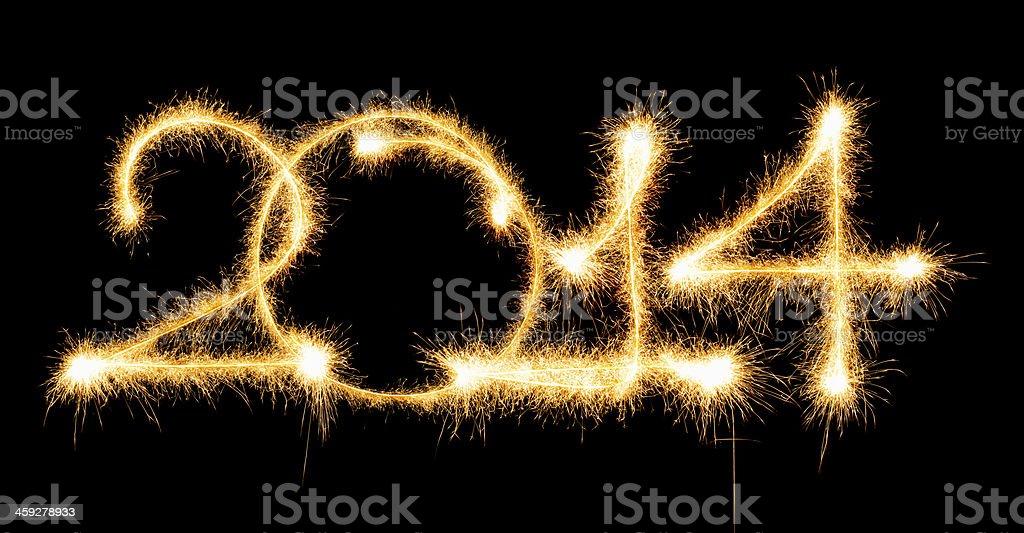 inscription 2014 made a sparkler stock photo