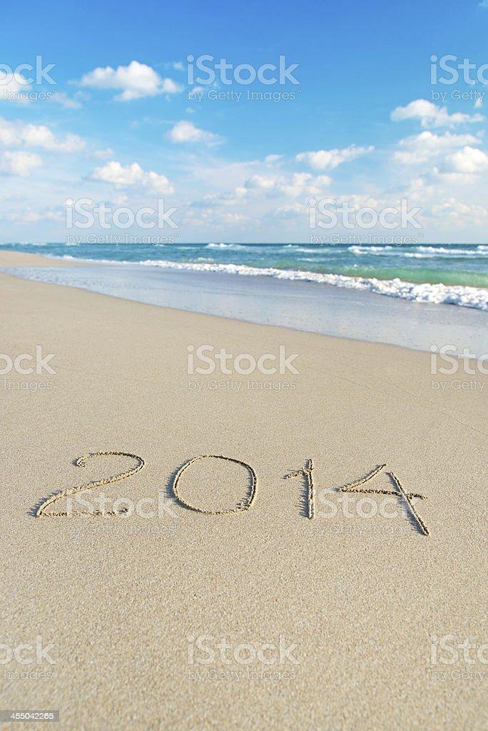 inscription 2014 on sea sand beach against wave royalty-free stock photo