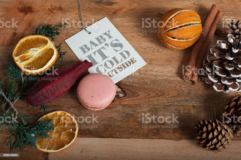 inscription Baby it's cold on blank tags, wooden table stock photo