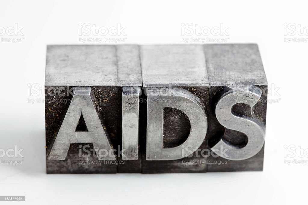 AIDS inscription close-up, typescript fonts royalty-free stock photo