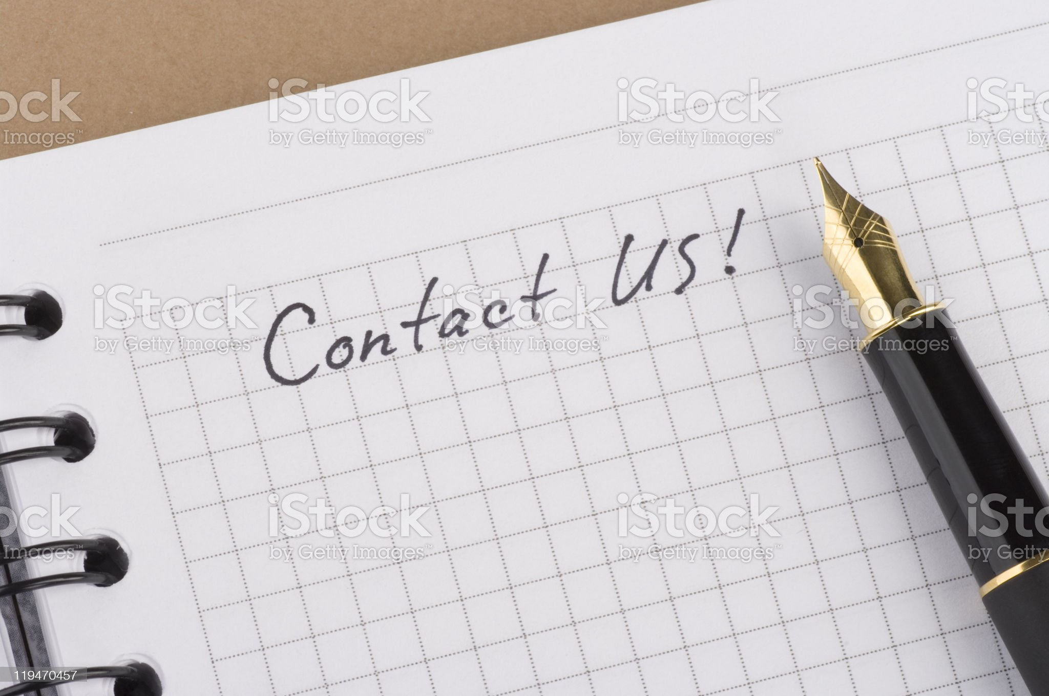 Inscription Contact us with gold pen royalty-free stock photo