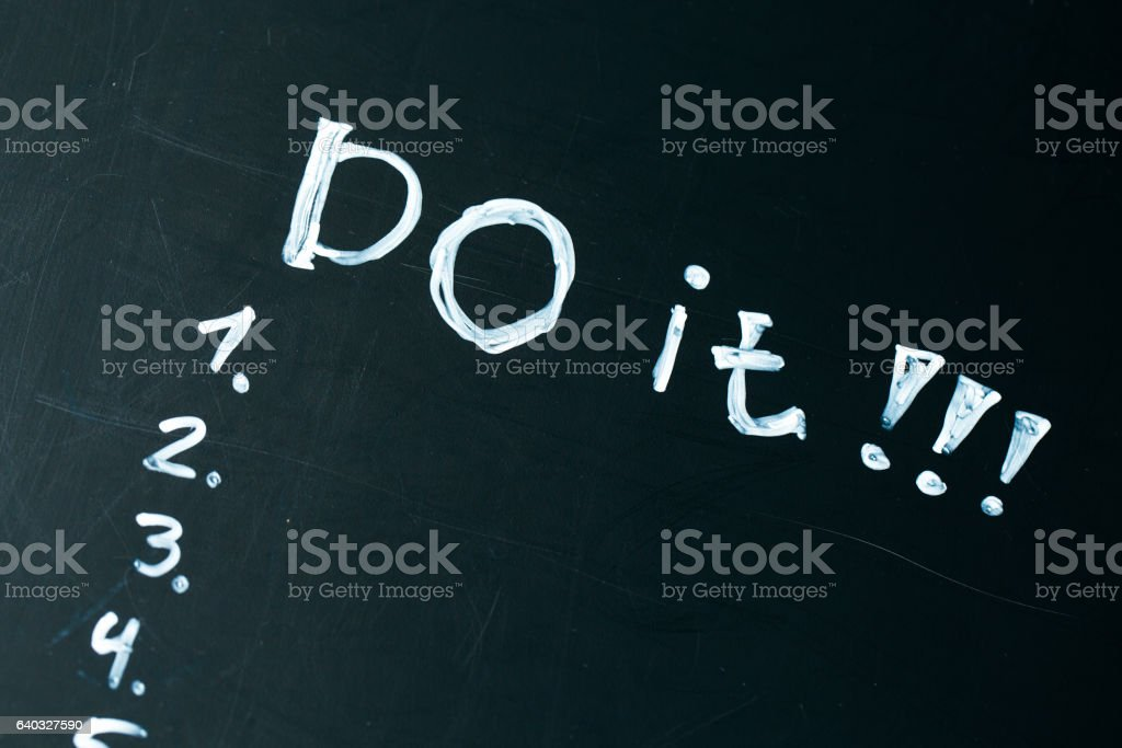 inscription do it list drawn with chalk on a school stock photo