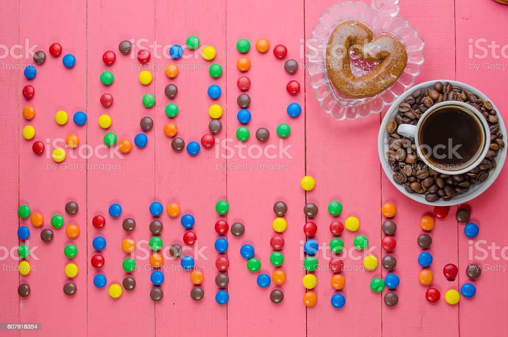 inscription from candies on a pink background stock photo