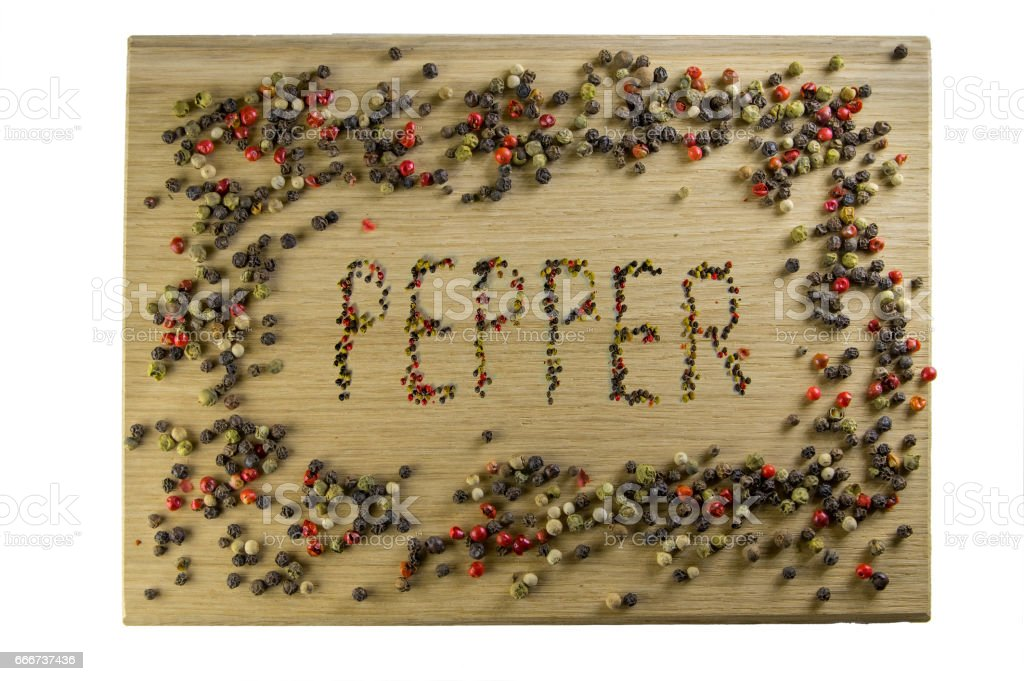 Inscription of peppers on a cutting board, made with pepper, in a frame of pepper. stock photo