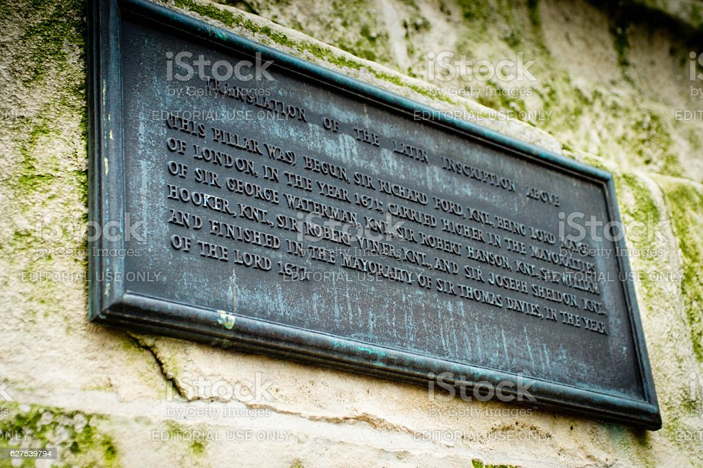 Inscription on the base of The Monument in London stock photo