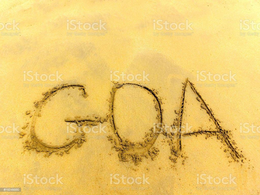 Inscription on the sand Goa . stock photo