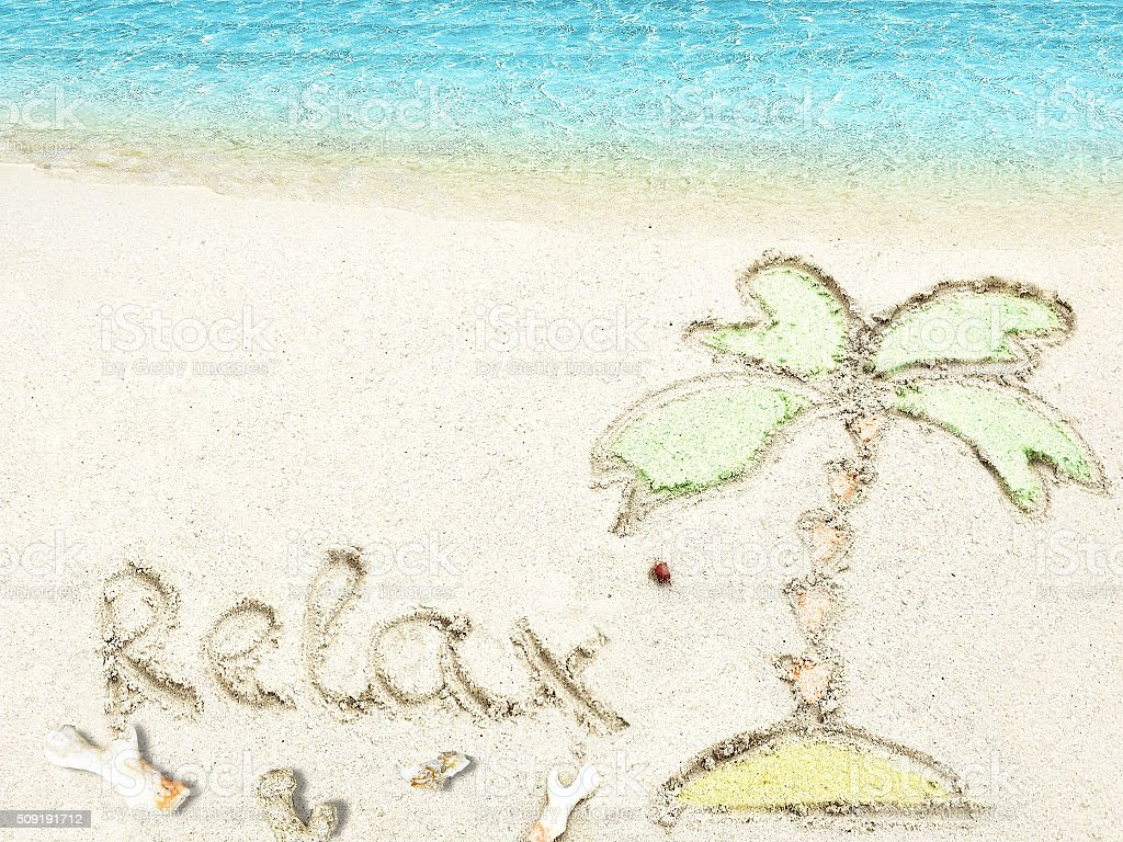 Inscription 'Relax' in the sand on a tropical island,  Maldives. stock photo