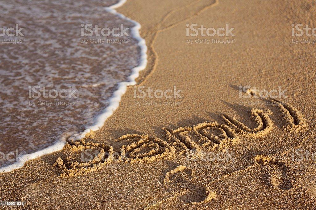 Inscription Samui on the sand stock photo