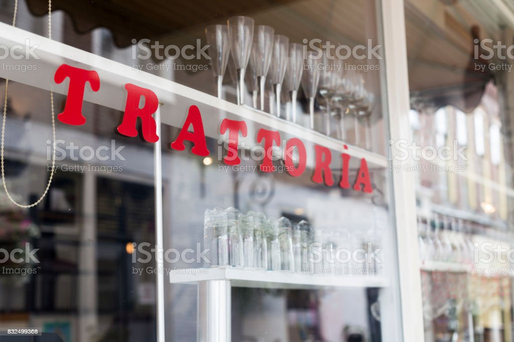 Inscription Trattoria on the window glass at cafe stock photo