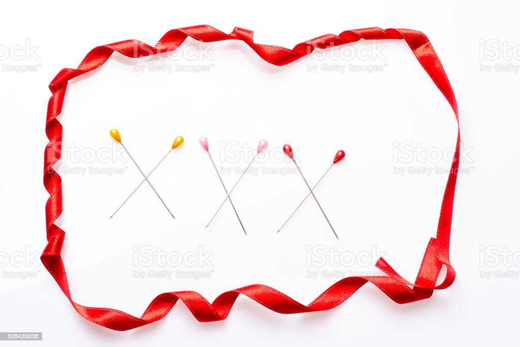 XXX inscription written with sewing pins stock photo