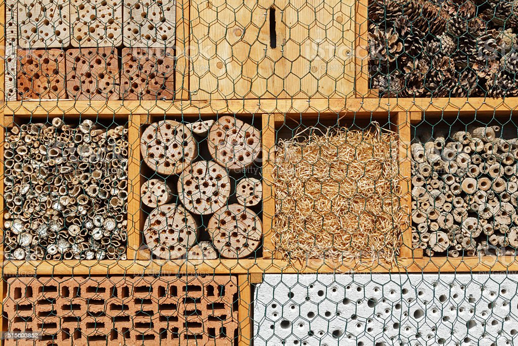 Insect hotel: Artificial nisting aid for solitary bees and wasps stock photo