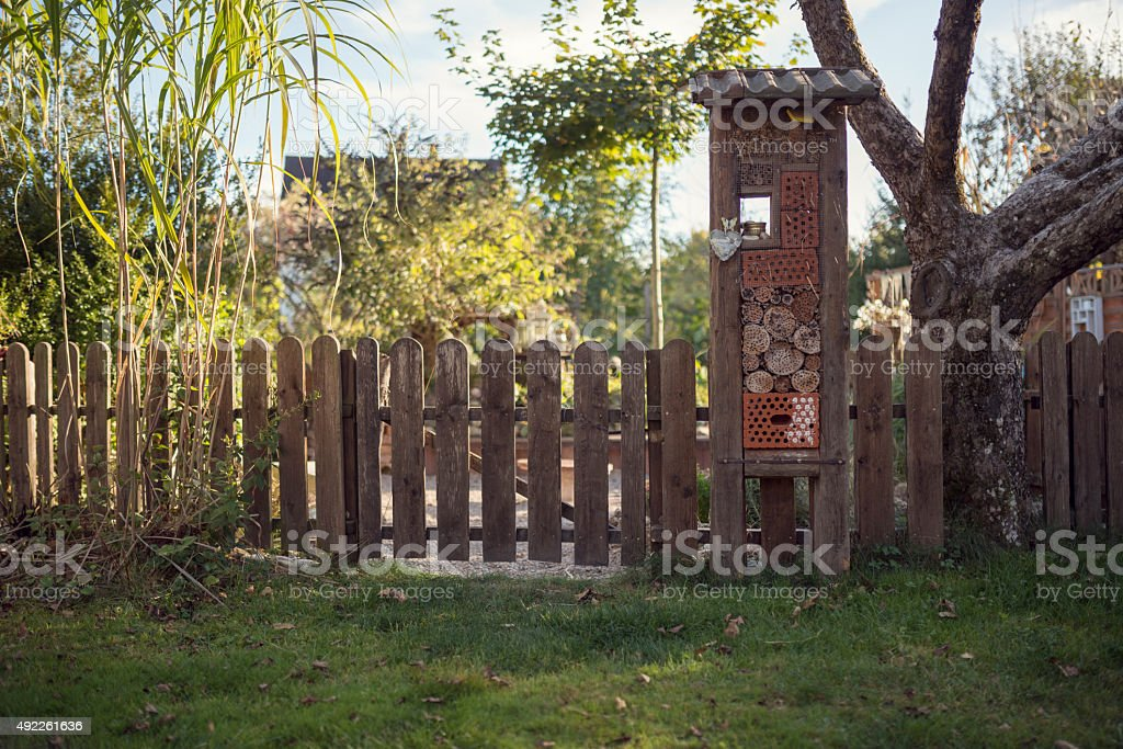 Insect hotel at a fence in a garden stock photo