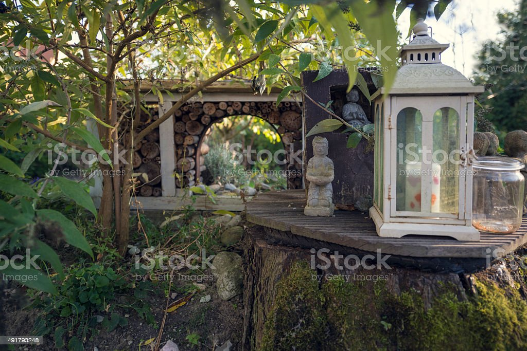 Insect hotel with garden arangement stock photo