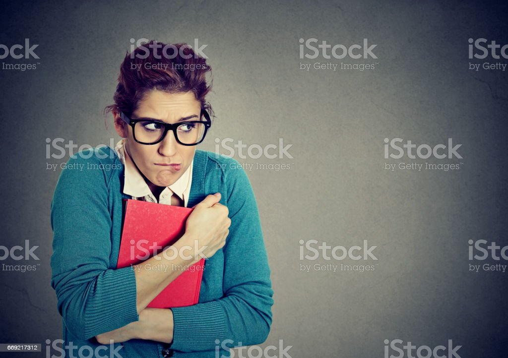 Insecure nerdy young woman student stock photo