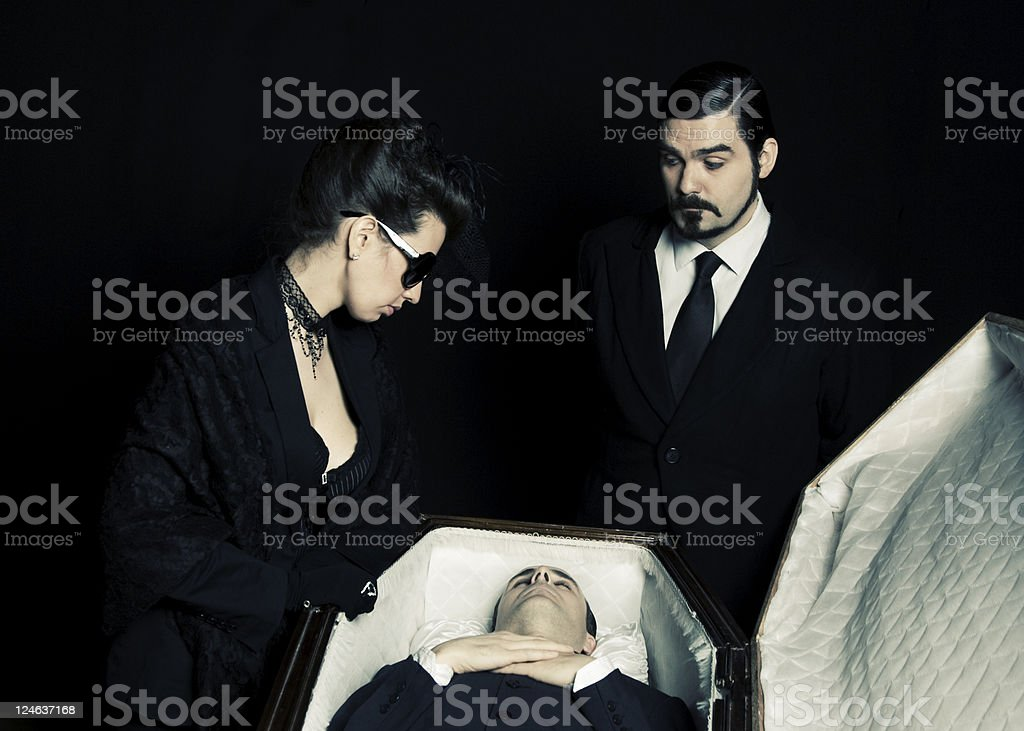 Insensitive Undertaker and grieving widow stock photo