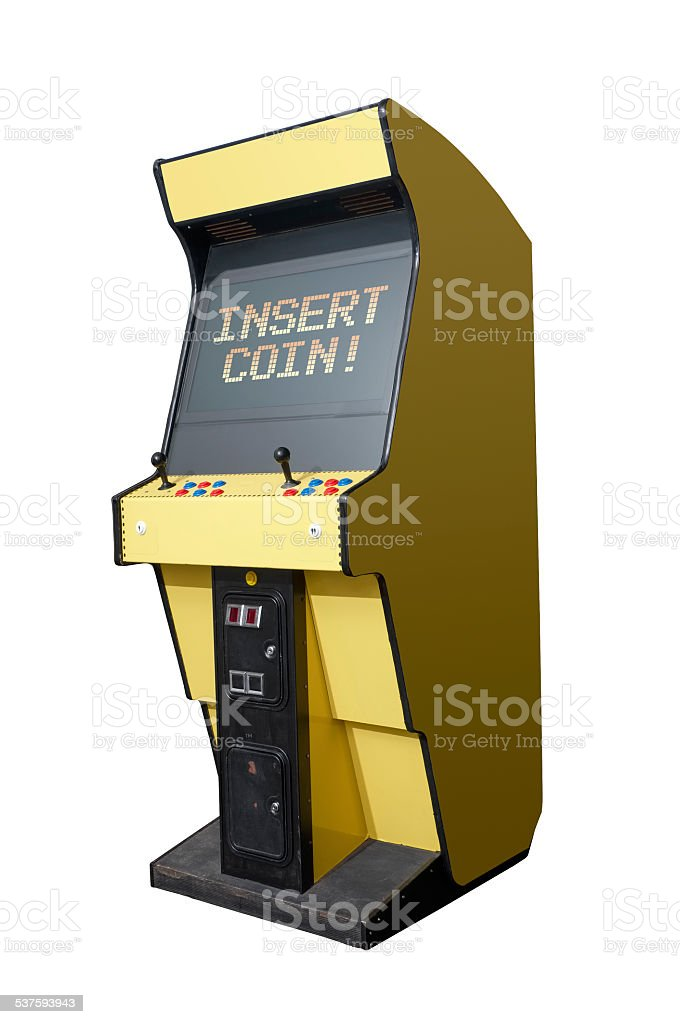 Insert coin on arcade machine stock photo