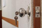 Insert key into lock (beside)