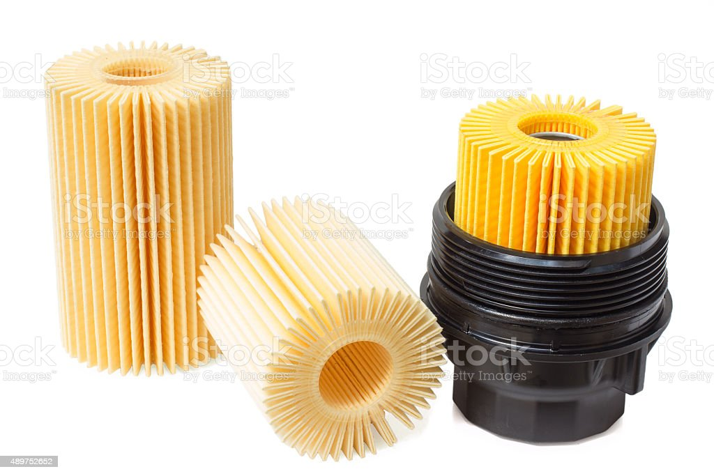 insert the engine oil filter with housing stock photo