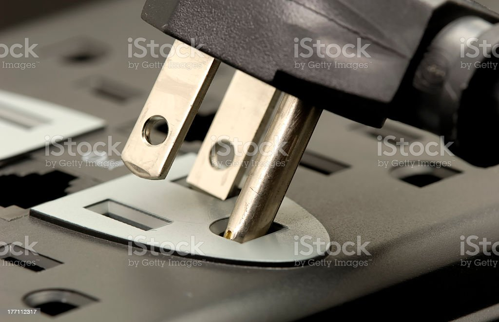 Inserting a black plug into the correct socket stock photo