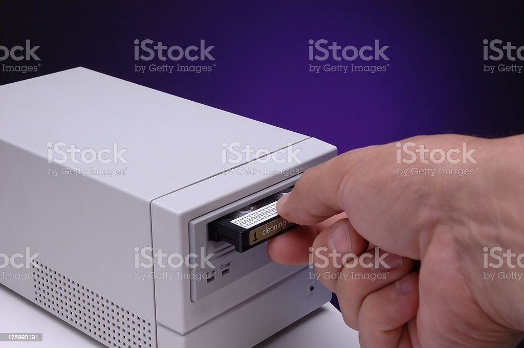 Inserting a cleaning tape stock photo