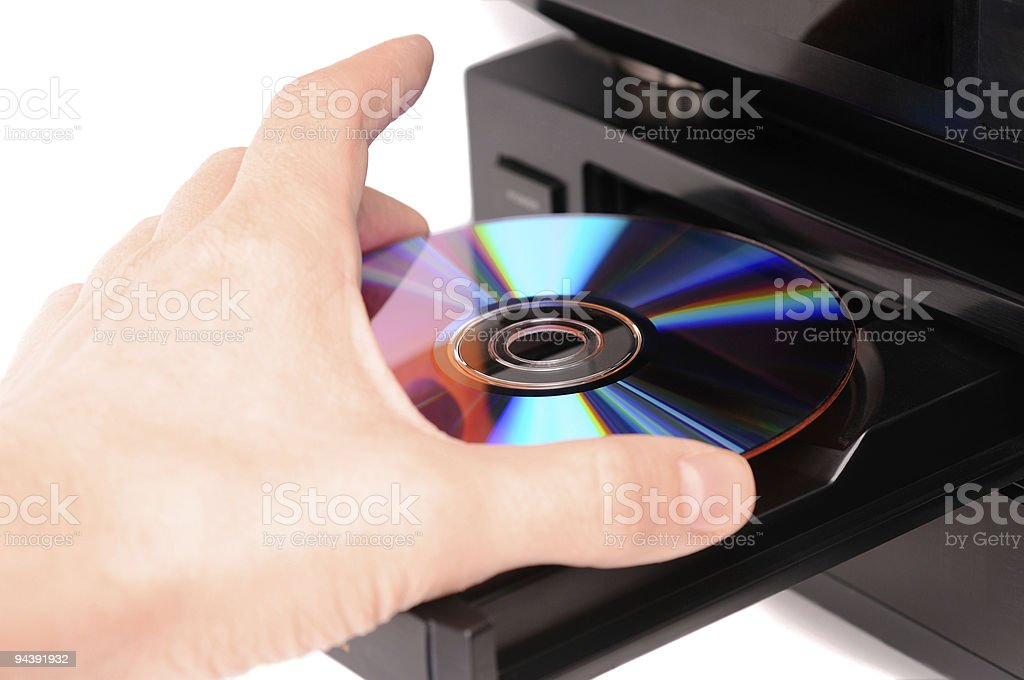 Inserting a disc stock photo