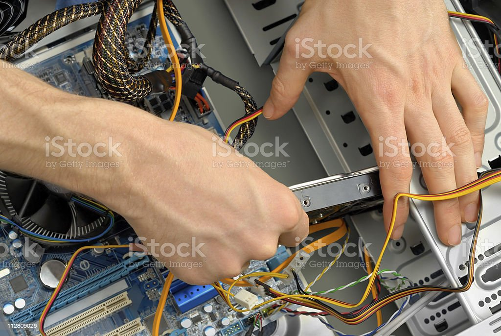 Inserting a hard drive stock photo