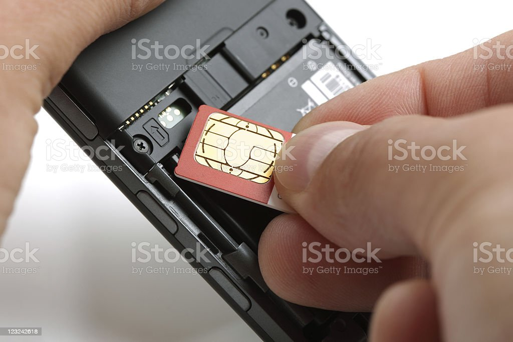 Inserting a sim card stock photo