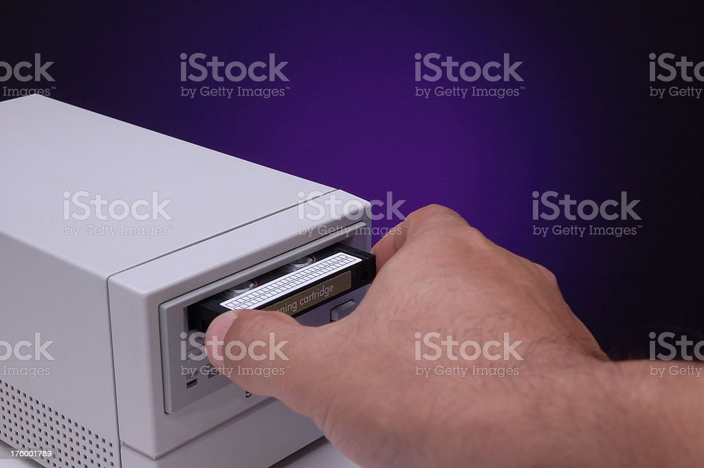 Inserting a tape for backup stock photo