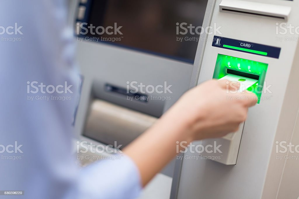 Inserting bank card into ATM stock photo