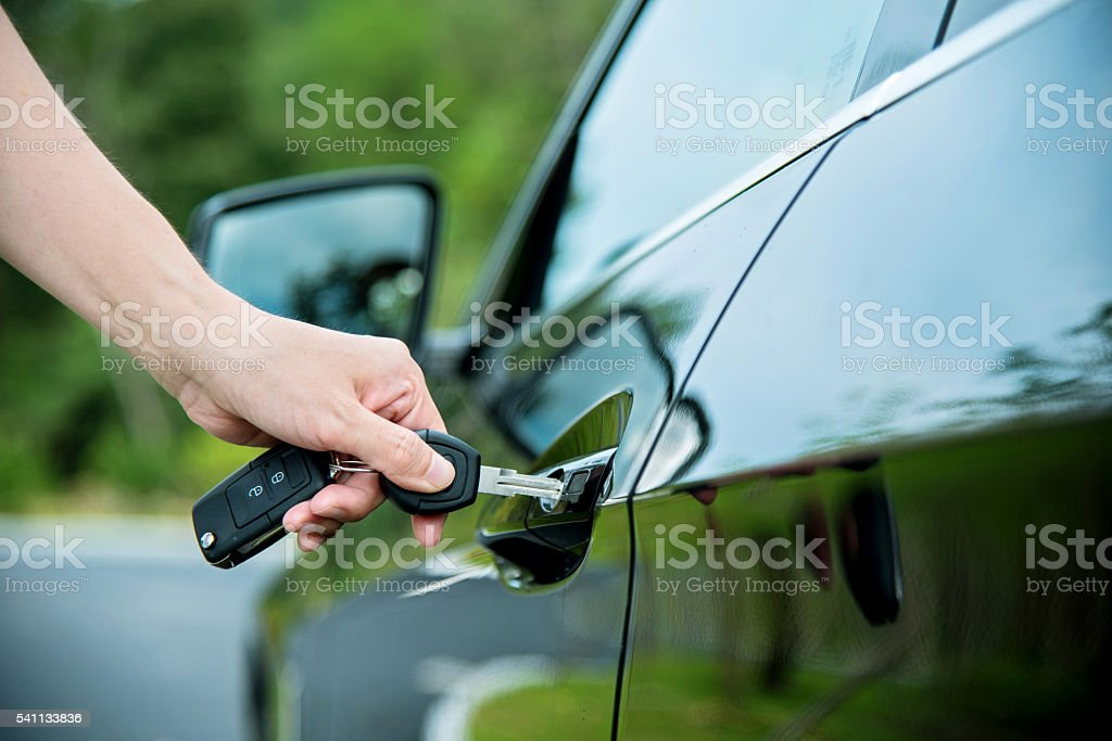Inserting car key stock photo