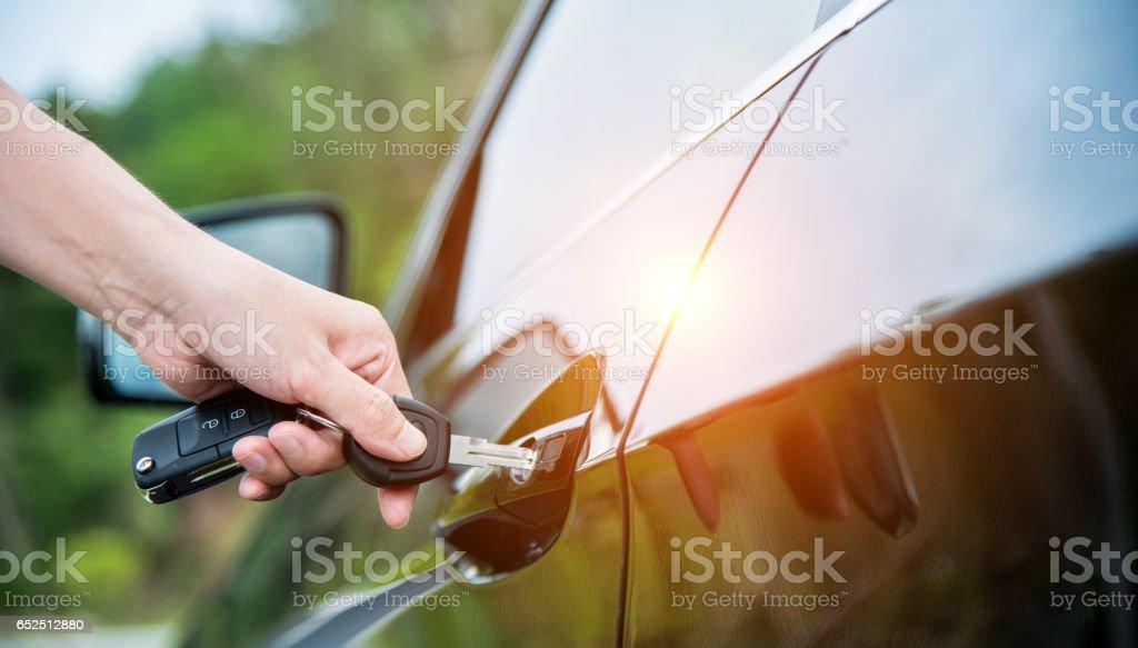 Inserting car key stock photo