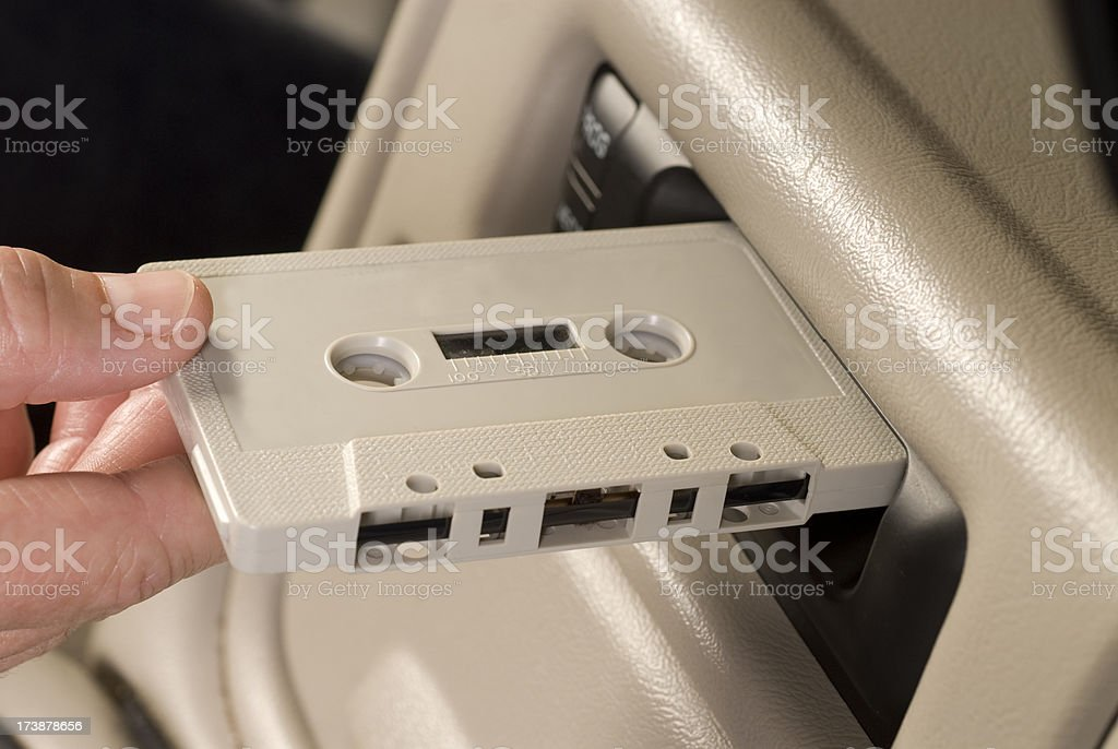 Inserting cassette in retro car stereo royalty-free stock photo