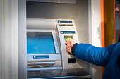 Inserting credit card in atm