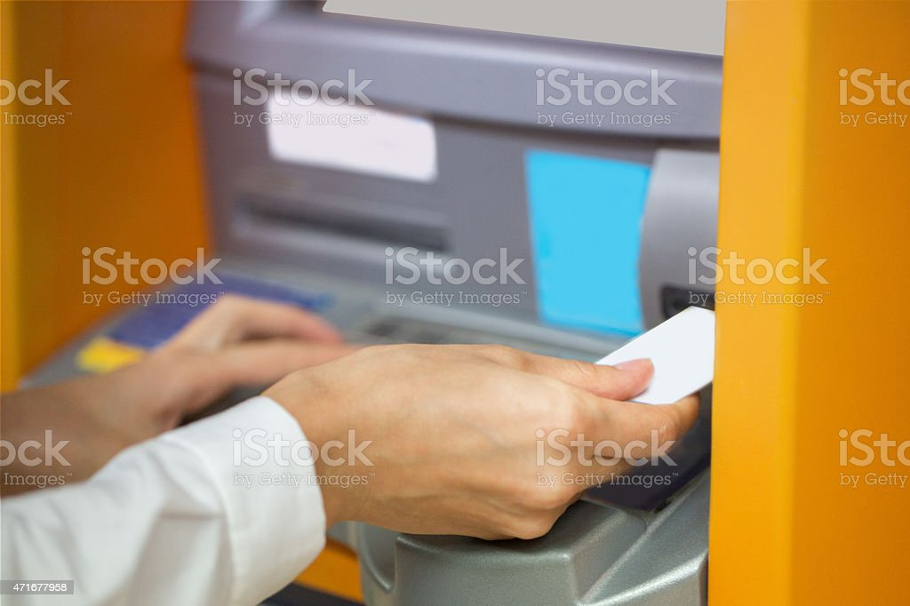 Inserting debit card stock photo