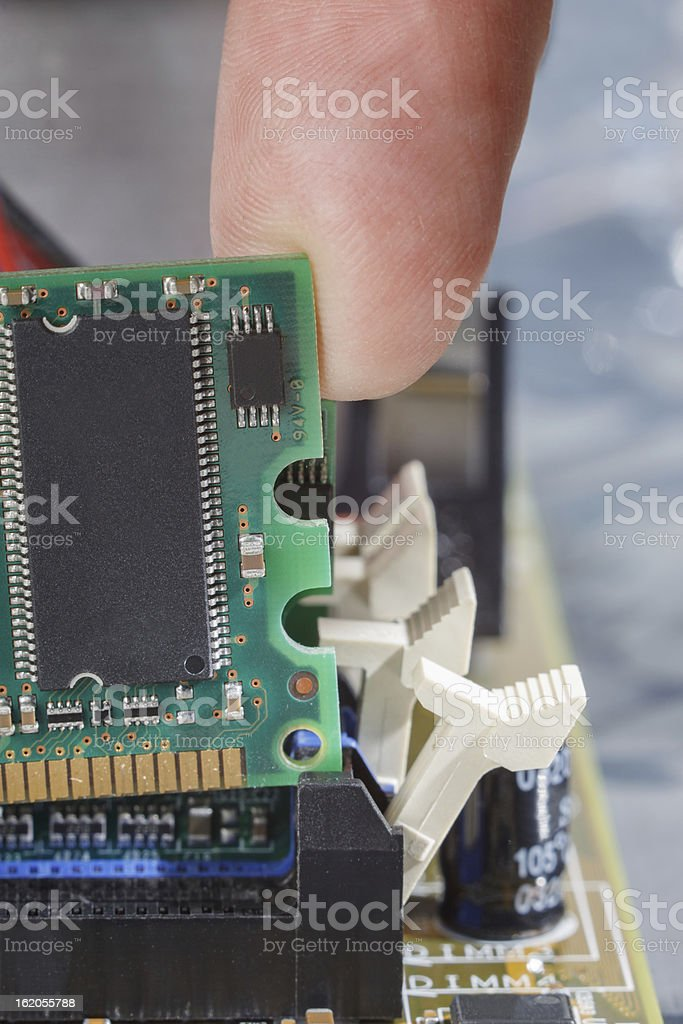 Inserting memory in slot on mother board royalty-free stock photo
