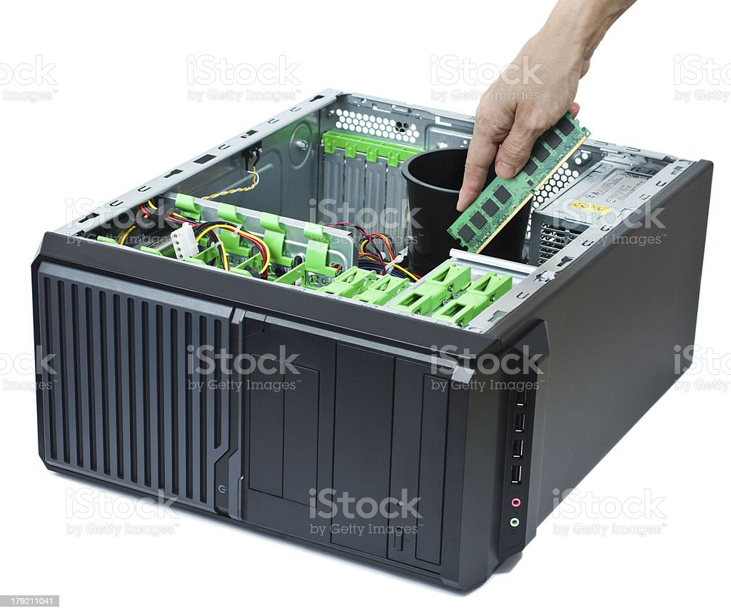 inserting memory into open computer royalty-free stock photo