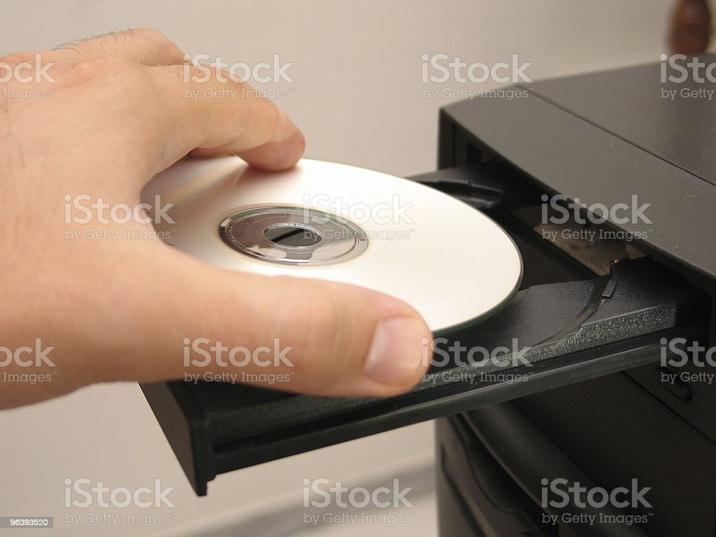 Inserting the CD stock photo