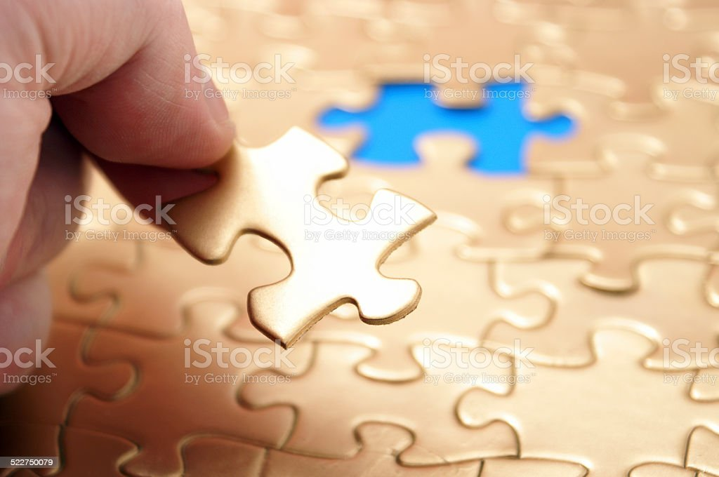 Inserting the Final Piece stock photo