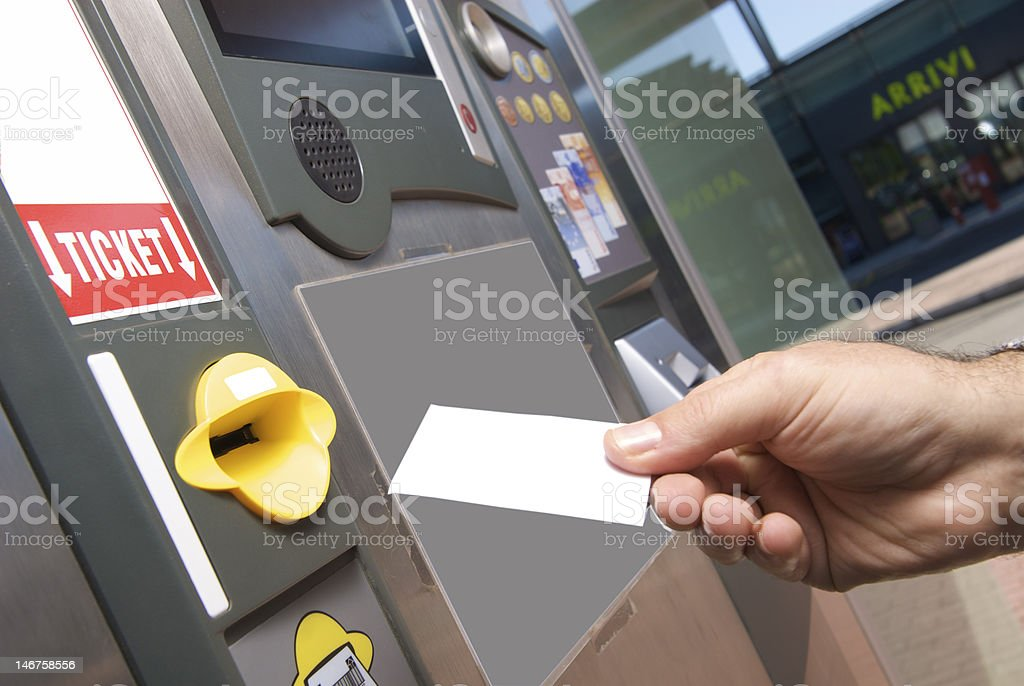 inserting ticket for airport parking area stock photo