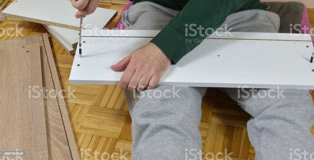 Inserting Wood Screw stock photo