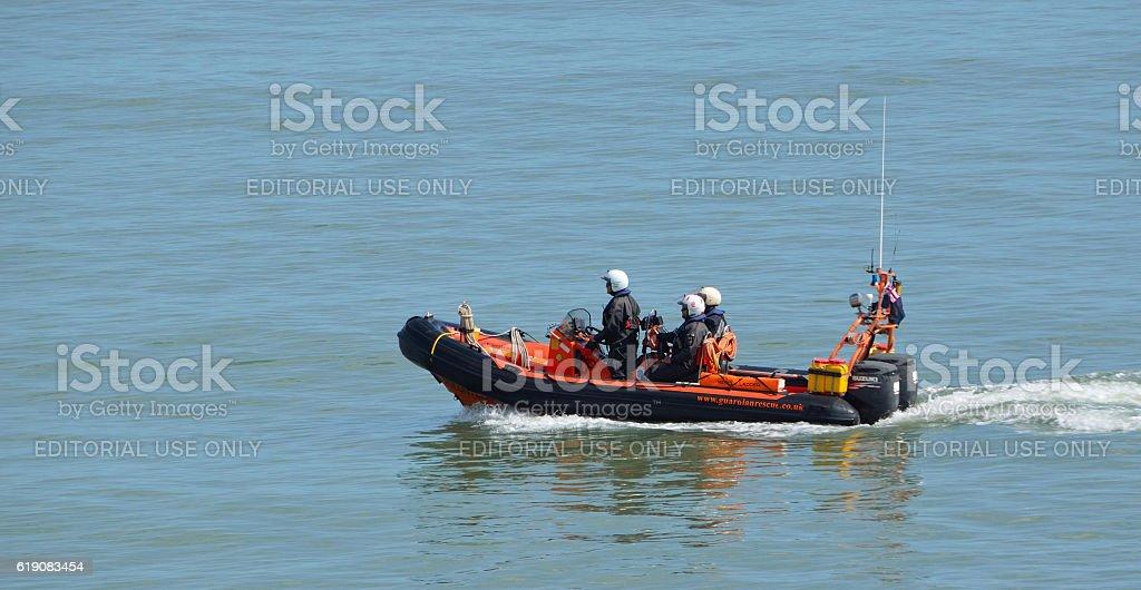RNLI Inshore rescue boat and crew stock photo