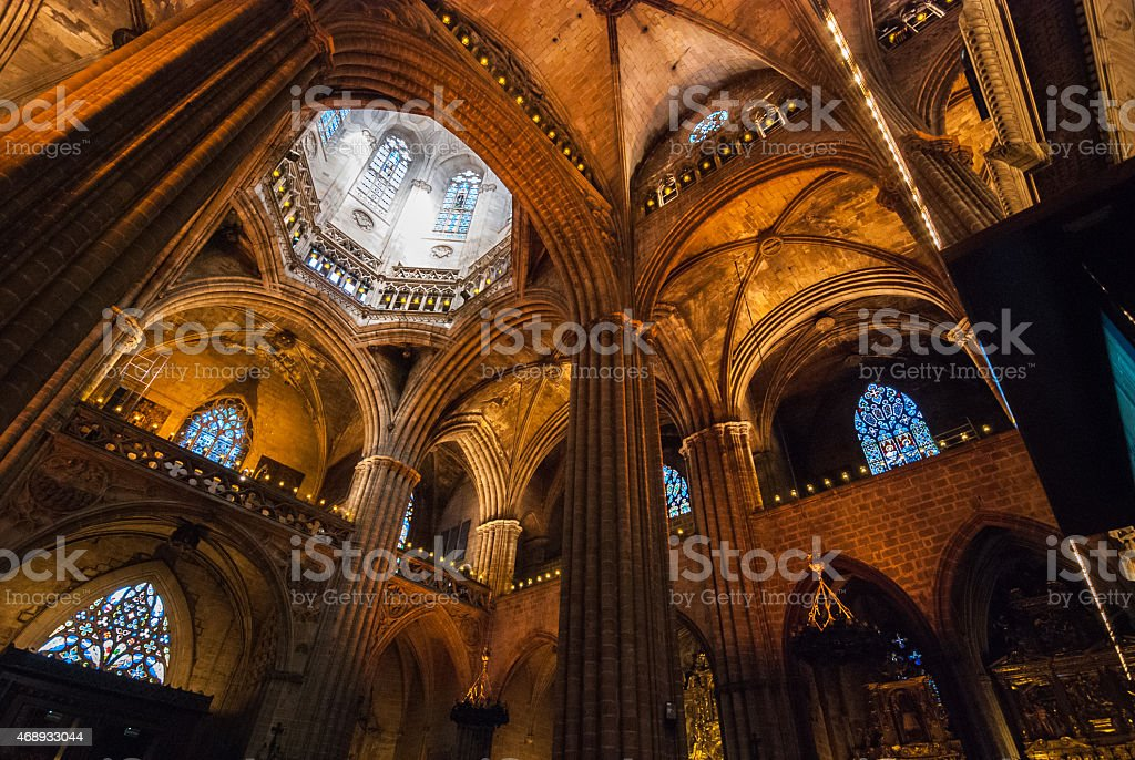 Inside a colossal Cathedral in Barcelona, Spain. stock photo