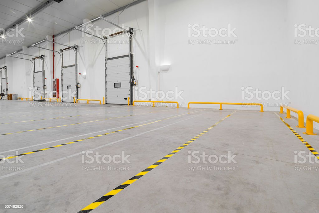 Inside a large empty new warehouse stock photo