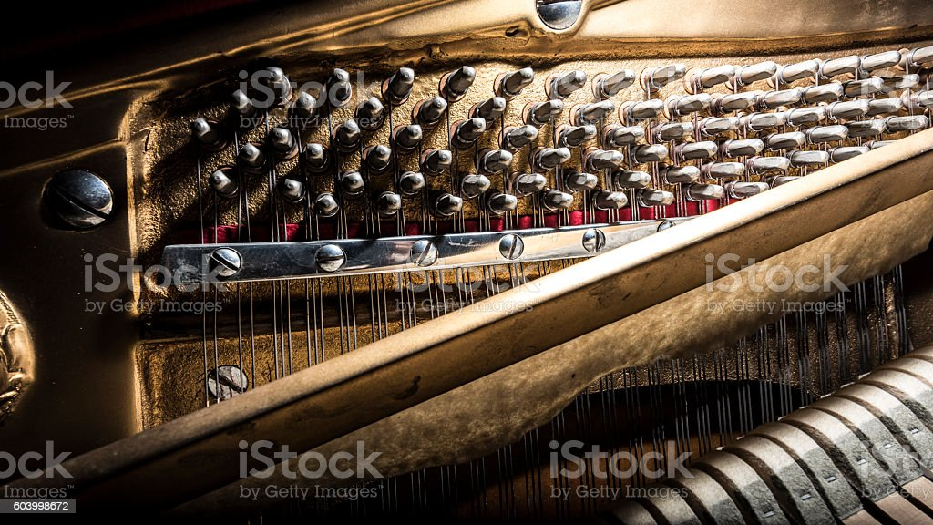inside a piano, wooden parts, mechanisms closeup stock photo