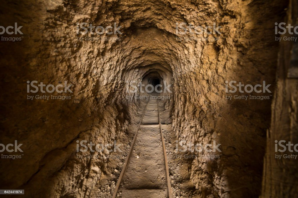 Inside abandoned gold mine tunnel or shaft in the Nevada desert. stock photo